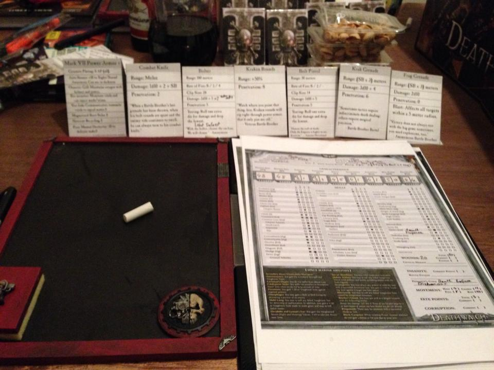This is Jon's dataslate, amidst his notes and wargear cards.