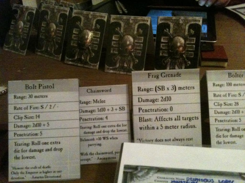 A better shot of some of my wargear cards. You can see the back of Ross's cards - all of them have the Deathwatch Inquisition symbol on the back.