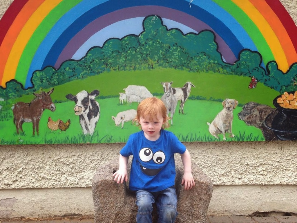 ...and the second is this one, where my diminutive heir sits commandingly astride a rainbow-burnished, animal-commanding Irish version of the Iron Throne. I wanted to make a reference to the rainbow looking like the Gay Pride flag, but I'm not 13.
