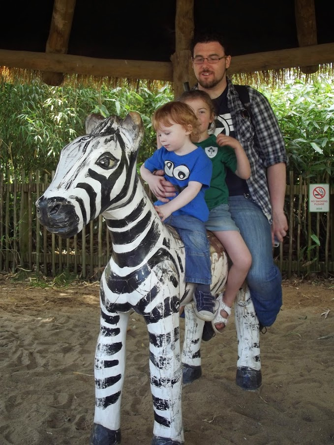 Here's John, who plays the Imperial Fist Tactical Marine in my Deathwatch group. Also pictured are one of his nieces, my son and heir, and a fake zebra. Dublin Zoo is some cheap-ass shit, let me tell you. Maybe real zebras cost too much? I don't know. The international shipping costs of African animals isn't my area of expertise, to be honest. I'm sorry if I've led you to believe otherwise.